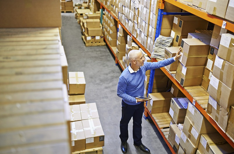Shot of a mature man working inside a printing and distribution factory